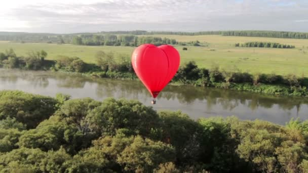 Aerial view of hot air balloon over the river