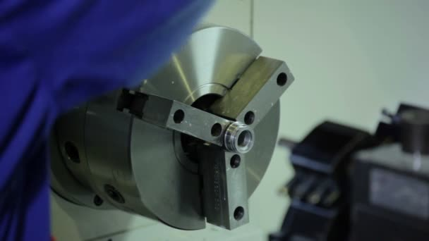 Lathe works metal in factory