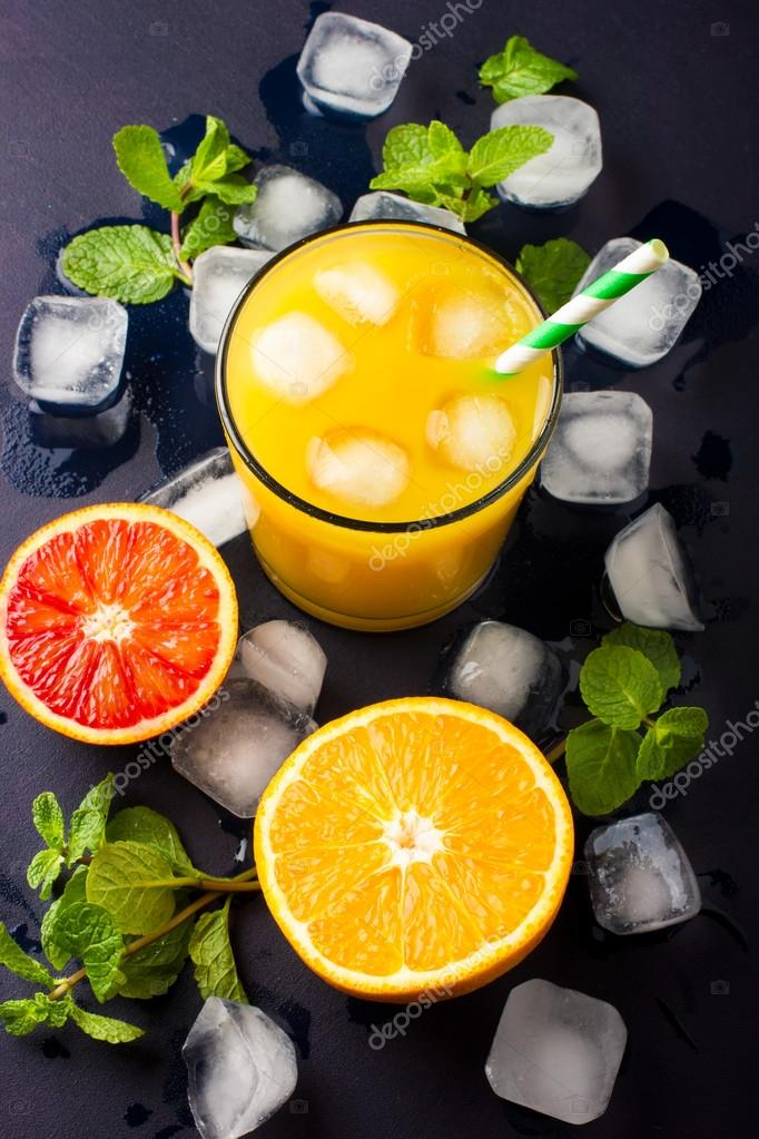Fresh orange juice on dark background