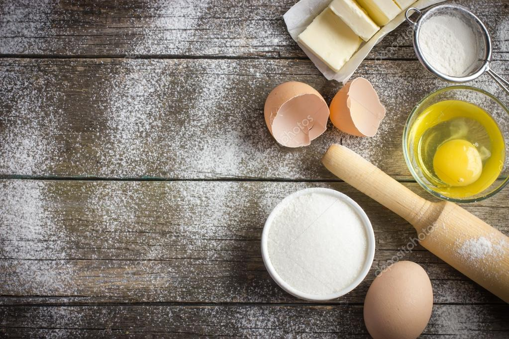 Ingredients for baking on the old wooden table