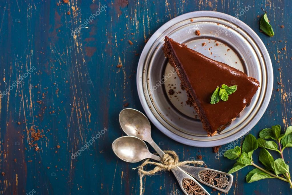 Chocolate cake with mint leaves