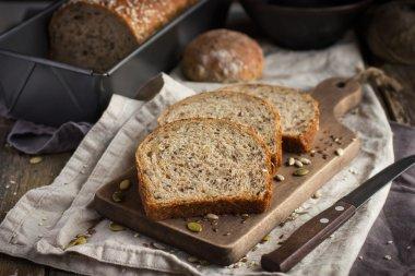 fresh  multigrain bread on rustic background