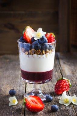dessert with  berries,  cream cheese, granola  and berries  jam
