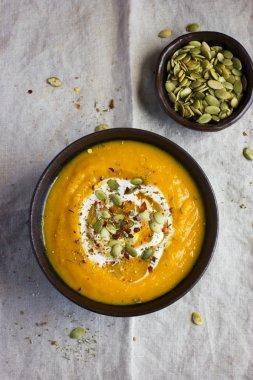 pumpkin soup with pumpkin seeds  on a bowl