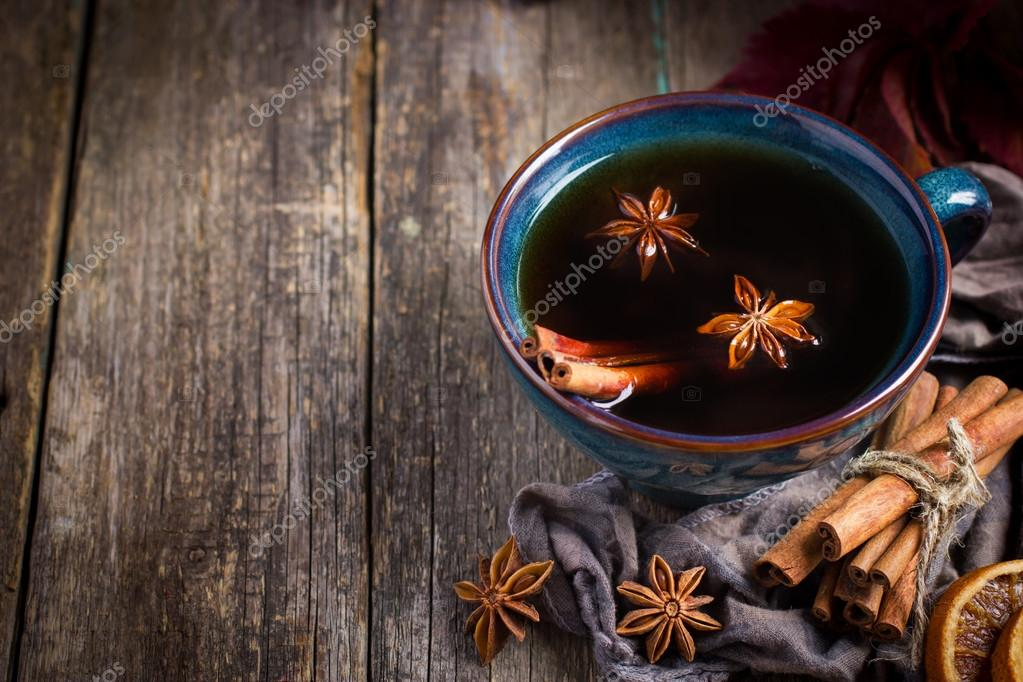 Cup of hot spicy tea with anise and cinnamon, selective focus