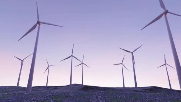 větrná elektrárna při západu slunce s pomalu rotujícími čepeli věží