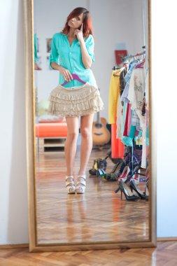 Girl trying wardrobe in dressing room
