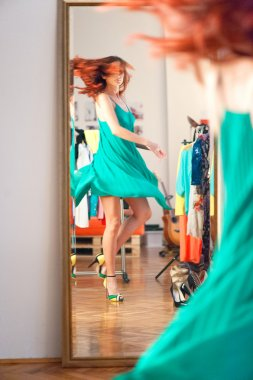Girl trying wardrobe in dressing room