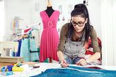 Fotografie Designer measuring textile material
