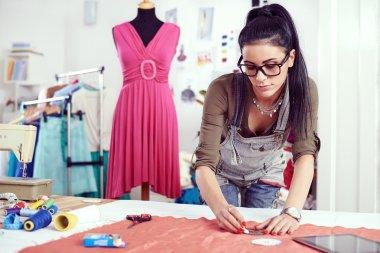 Designer measuring textile material