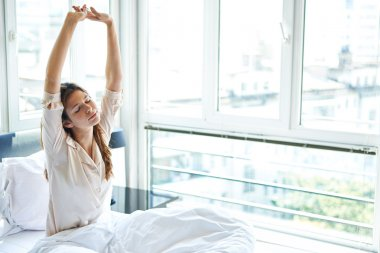 Woman stretching after wake up