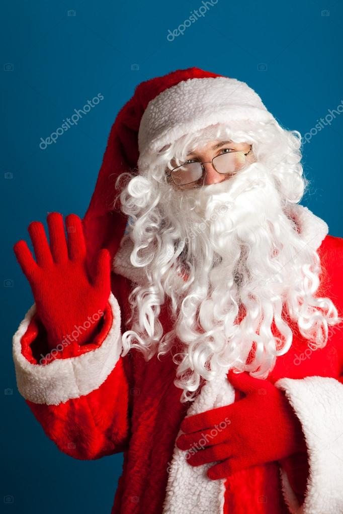Santa Claus with red costume waving with hand
