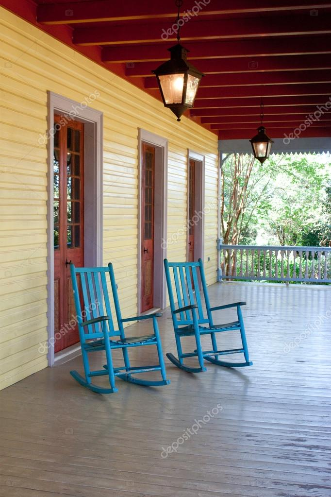 Two empty rocking chairs u2014 Stock Photo & Two empty rocking chairs u2014 Stock Photo © aspendendron #56978913