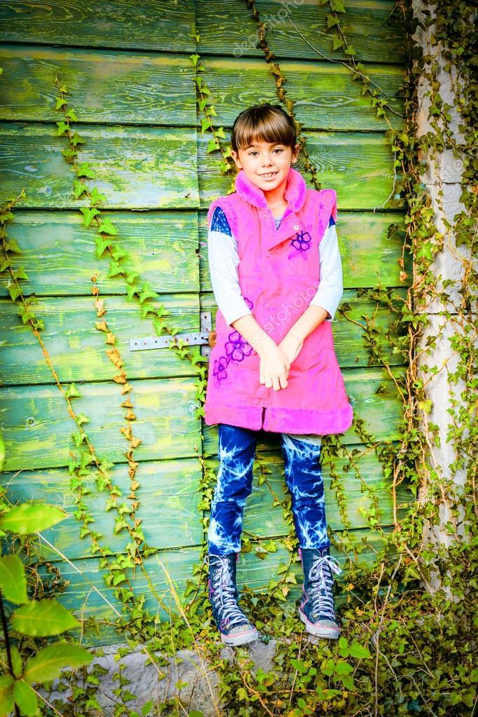 Little girl standing in front of the doors