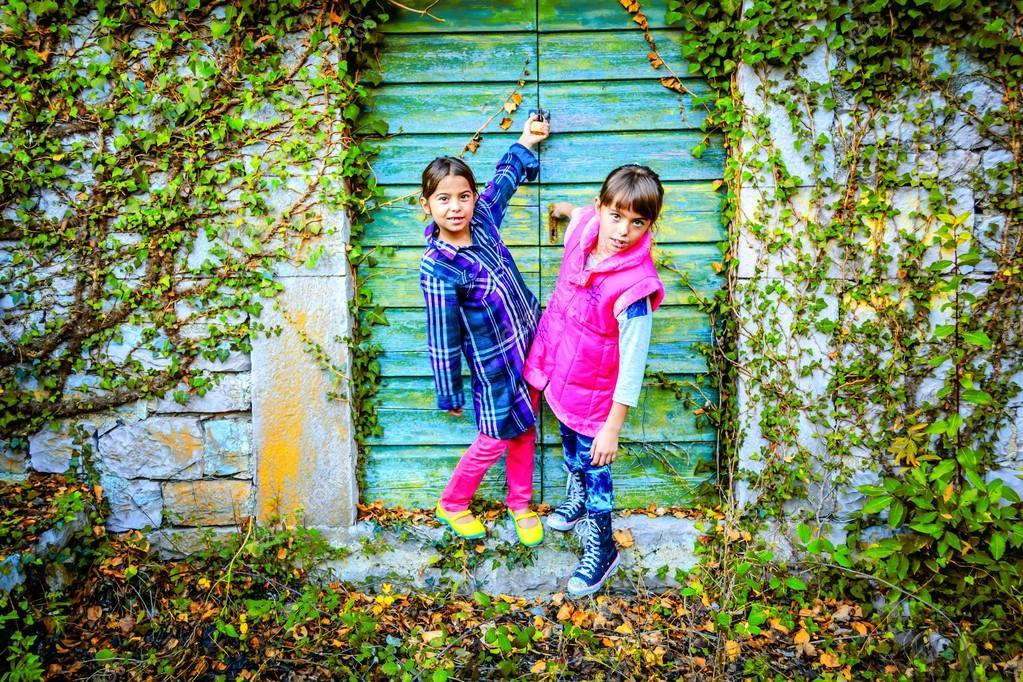 Little girls standing in front of the doors