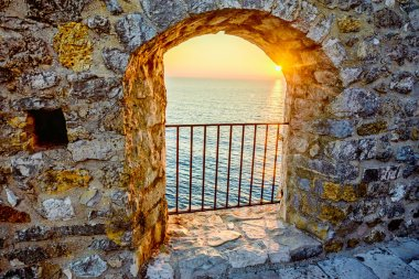 View on the sea from the fortress window in old town Ulcinj, Mon