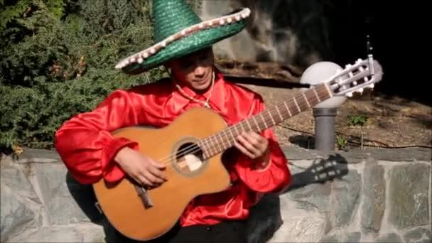 Cuban musician plays guitar in park