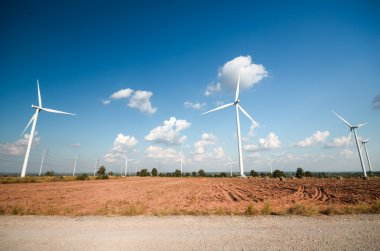 wind turbine against cloudy blue sky background