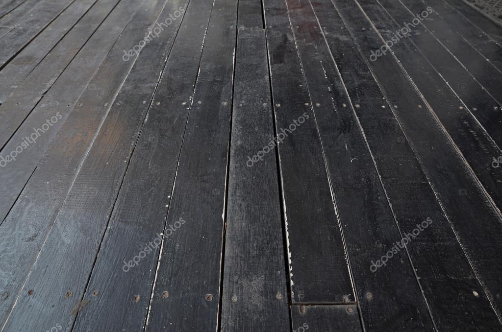 Grunge zwarte houten vloer voor achtergrond u stockfoto