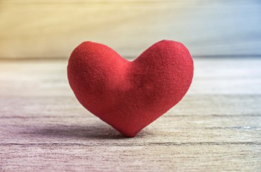 red heart shape on wood background