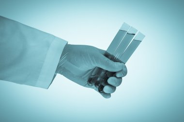 Scientist hand holding test tubes