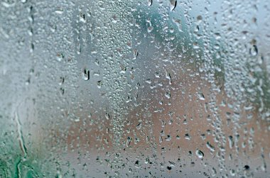 natural water drops on glass window