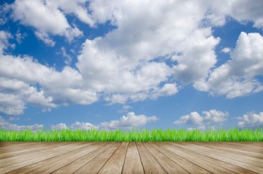 Wooden platform and blue sky background