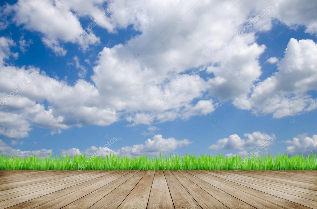 Wooden platform and blue sky background