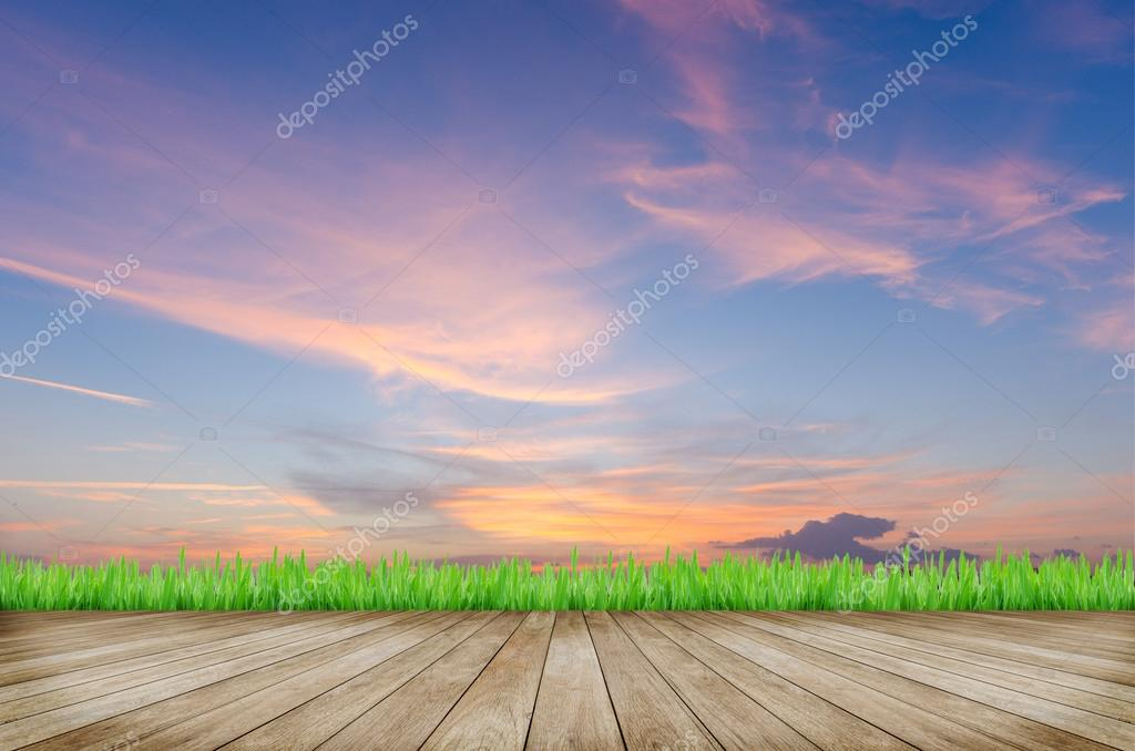 Wooden platform and sunset sky background
