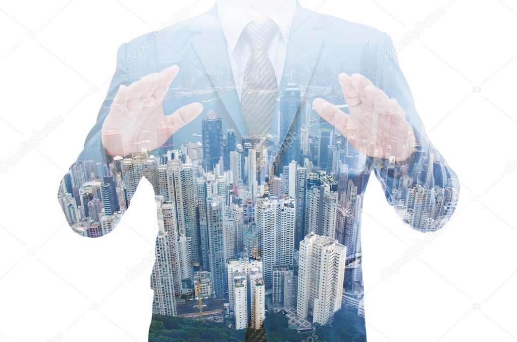 Double exposure of business man with modern building background