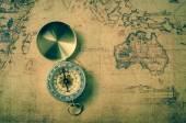 Fotografie vintage compass on old map