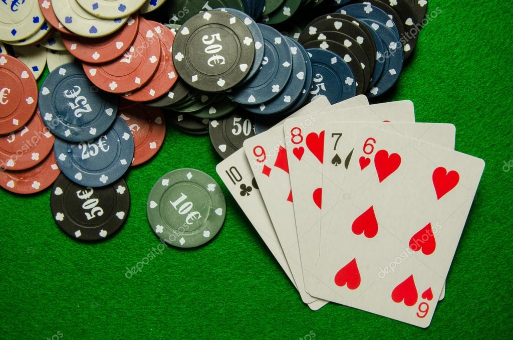 Playing cards 'Straight' and chips on green background
