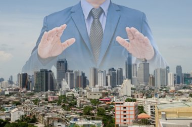 Double exposure of business man over the city