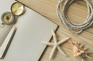 blank paper with pencil and compass on sea-shells background