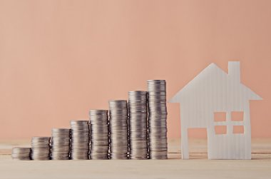 House model and stack of coin