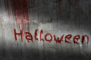 blood text halloween on grunge stone wall