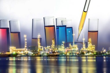 Double exposure of laboratory test tube and Oil refinery plant