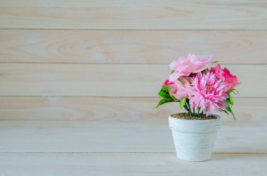 white flower pot on wooden table background