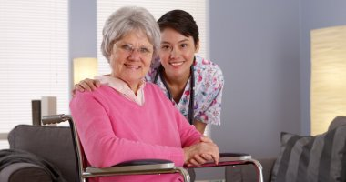 Asian nurse smiling with Elderly patient