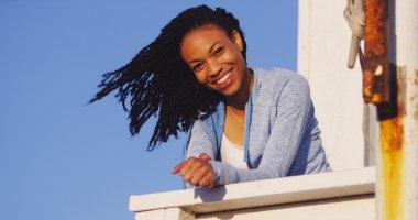 African woman smiling at camera