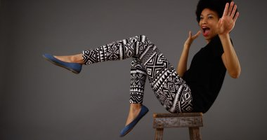 Black woman dancing on chair