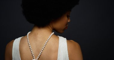 Black woman wearing elegant pearl necklace