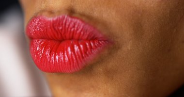 Closeup of woman puckering lips