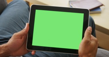 Closeup of tablet with greenscreen