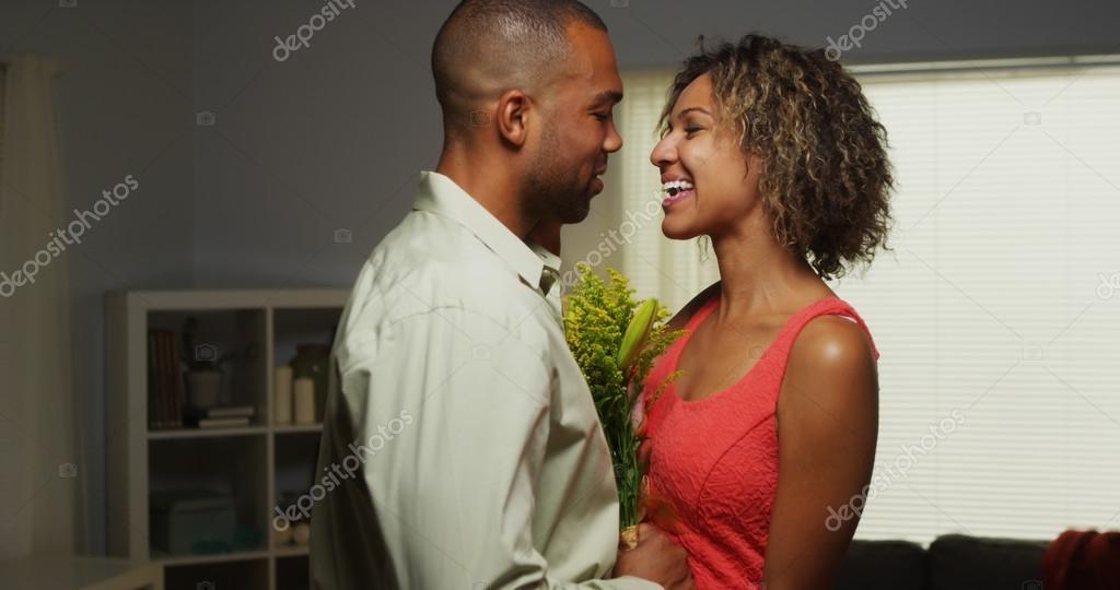 Black boyfriend surprises girlfriend with flowers