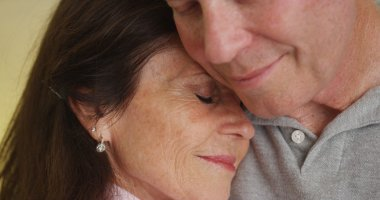 Loving older couple hugging each other