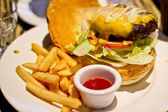 Traditional american burger, freshly french fries