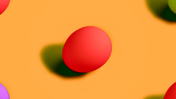Colorful Easter Eggs rotating in rows in seamless loop on orange background.