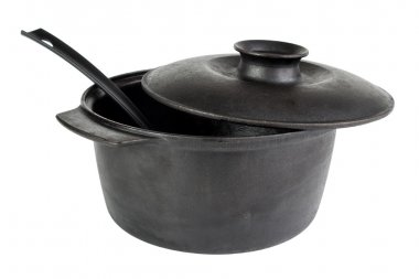 Old cast iron cauldron with scoop