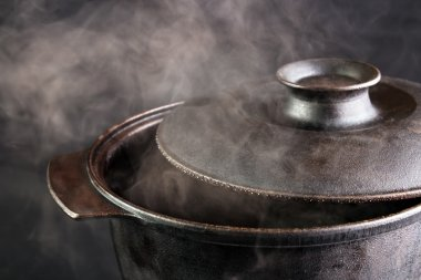 Steaming iron pot with opened cover